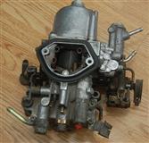 Karburator za mitsubishi lancer 1,5  1991god.
